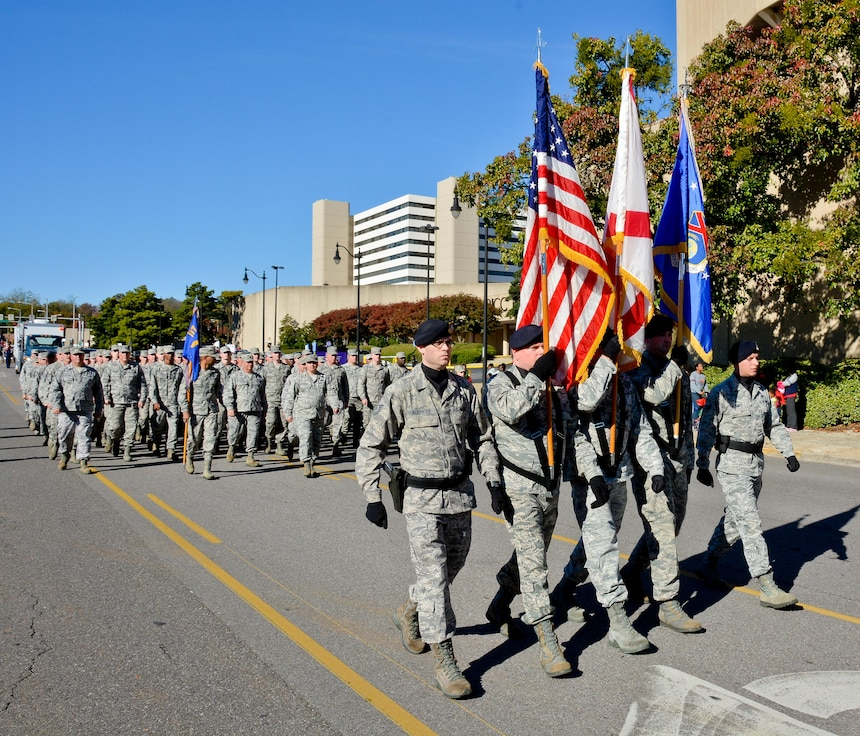 Members from the 117th Air Refueling Wing march in the 2013 National Veterans Day Parade in Birmingham, Alabama. The Birmingham National Veterans Day Parade which began in 1947 is the nation's oldest and longest Veterans Day Parade. (U.S. Air National Guard photo by Master Sgt. Ken Johnson/Released)
