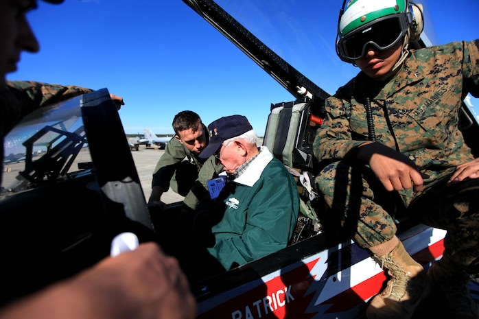 Marines with Marine Fighter Attack Squadron 115 explain the capabilities of the F/A-18 Hornet to retired Maj. William H. Hodson, a VMFA-115 alumnus, during the annual VMFA-115 reunion held aboard Marine Corps Air Station Beaufort, Nov. 8. Hudson, a 90-year-old native of Tacna, Ariz., was a former pilot with the squadron when it was first commissioned in 1943. Activated on July 1, 1943, VMFA-115's reunion was part of the squadron's 70th anniversary celebration.