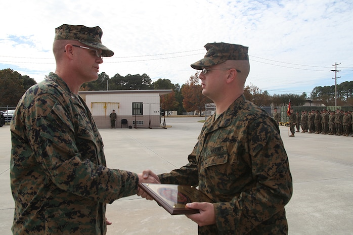 Cpl. Samuel Jarrell, a generator mechanic for Marine wing Support squadron 273, Engineer Company receives the Utilities Marine of the Year Award from Lt. Col. James Stone, the commanding officer of MWSS-273, during an award ceremony aboard Marine Corps Air Station Beaufort, Nov. 7. Jarrell received this award after more than 200 hours of heavy equipment operation, responding to 60 power generation trouble calls and providing more than 20,000 hours of uninterrupted power generation.