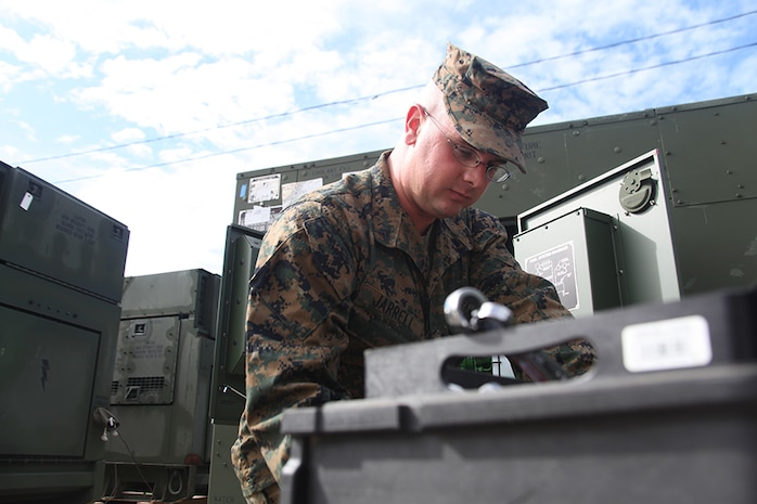 Cpl. Samuel Jarrell, a generator mechanic for Marine Wing Support Squadron 273, Engineer Company and recipient of the Utilities Marine of the Year Award, works on a generator aboard Marine Corps Air Station Beaufort, Nov. 5. jarrell received the award after more than 200 hours of heavy equipment operation, responding to 60 power generation trouble calls and providing more than 20,000 hours of uninterrupted power generation.