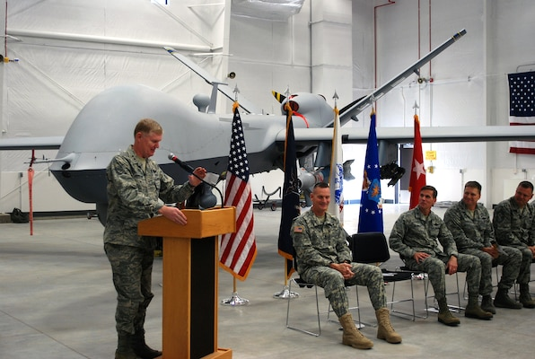 New York Air National Guard Commander Maj. Gen. Verle Johnston speaks during the ribbon cutting officially opening the MQ-9 Launch and Recovery Element Hangar on Nov. 5, 2013.
