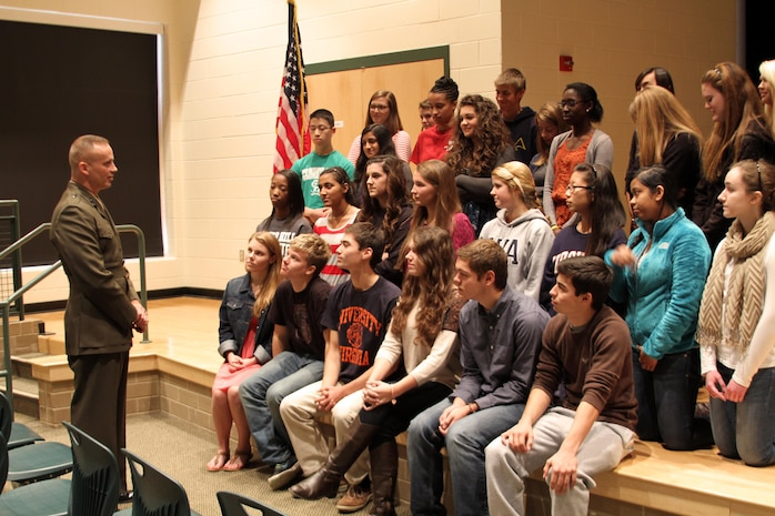 U.S. Marine Corps Brigadier General David Furness, left, Legislative Assistant to the Commandant of the Marine Corps, speaks to students of Clover Hill High School's National History Honors society, Nov. 8, 2013. Furness, who graduated from the school in 1980, returned to his hometown to accept a Bravo Award, but also took time to share experiences and talk about the importance of leadership to the students. (U.S. Marine Corps photo by Cpl. Aaron Diamant/Released)