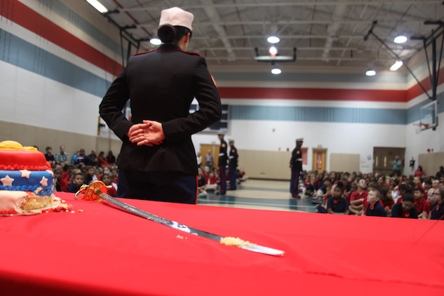 Military children throughout the Tri-Command celebrated the 238th Anniversary of the Marine Corps during a cake cutting ceremony held at Bolden Elementary Middle School aboard Laurel Bay, Nov. 7.