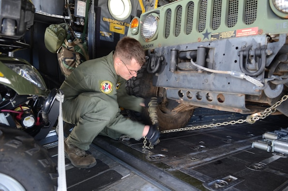 Senior Airman Timothy Oberman secures a Humvee inside an aircraft, Nov. 14, 2013, at Andersen Air Force Base, Guam, before departing insupport Operation Damayan in Tacloban, Philippines.  The U.S. military's ability to respond rapidly to the Philippine government's request reaffirms the value of the close cooperation our two nations share. The Filipino people are responding to this setback with characteristic resilience, aided by the effective measures their government took to help prepare them for the storm. Oberman is a 36th Airlift Squadron C-130 Hercules loadmaster.