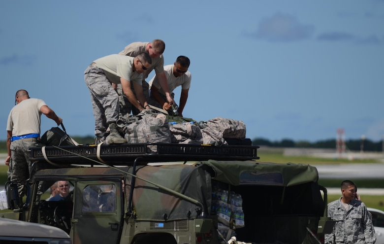 Airmen from the 36th Contingency Response Group secure equipment onto a Humvee Nov. 14, 2013, at Andersen Air Force Base, Guam, before departing to support Operation Damayan in Tacloban, Philippines. The Humvee will be used to access the airfield at Tacloban to determine if it is fit to receive C-17 Globemaster IIIs with supplies and equipment in support of the relief efforts.