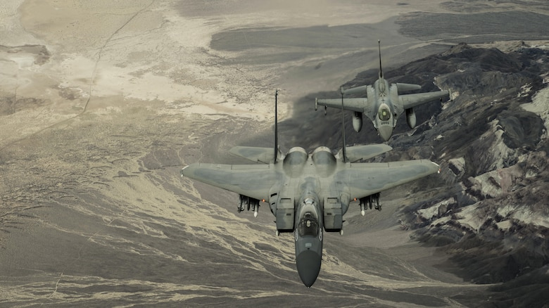 Col. John York pilots an F-15 Eagle ahead of Lt. Col. Sean Navin, who flies an F-16 Falcon on its final mission for the 144th Fighter Wing, California Air National Guard. The F-16s have been transferred to the 162nd Fighter Wing in Tucson, Ariz., as a result of the 144th Fighter Wing receiving the F-15 Eagle as their new airframe. York is the 144th Operations Group commander. Navin is the commander of the 194th Fighter Squadron.
