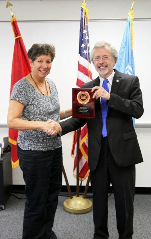 Merry Henley (left) receives the IWR Employee of the Year award from IWR Director Robert Pietrowsky (right).