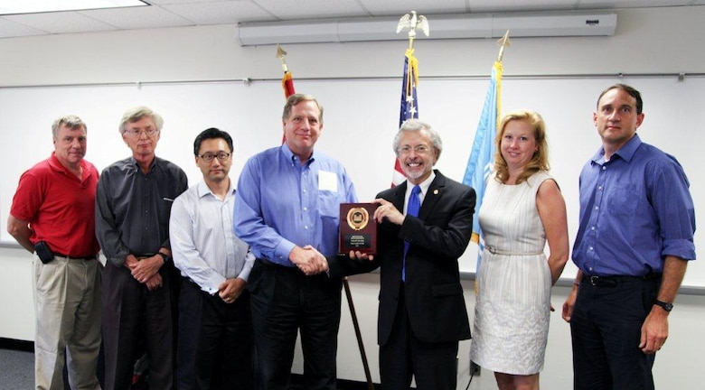 The U.S. Port and Inland Waterways Modernization Study Team receives the Team of the Year award from IWR Director Robert Pietrowsky (center). Team leader Keith Hofseth accepts the award for the team. Left to Right: Henri Langlois, Richard Cole, Jae Chung, Keith Hofseth, Robert Pietrowsky, Kelly Barnes, Hal Cardwell.
