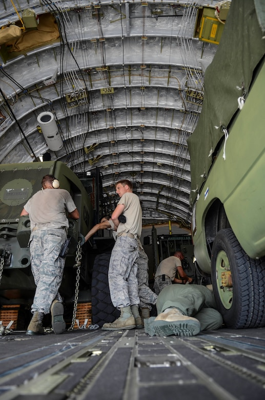 Airmen from the 36th Contingency Response Group secure vehicles into a C-17 Globemaster III Nov. 15, 2013, on the Andersen Air Force Base, Guam, flightline before departing to support Operation Damayan in Tacloban, Philippines. Operation Damayan is a U.S. humanitarian aid and disaster relief effort to support the Philippines in the wake of the devastating effects of Typhoon Haiyan. (U.S. Air Force photo by Senior Airman Marianique Santos/Released)