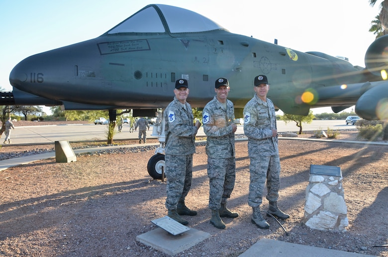 Senior Master Sgt's. Kevin Wendt, Todd Popovic and Brett McCracken pose for a photo after being congratulated by both NAF and Wing leadership for their selection to the rank of Chief Master Sergeant at Davis-Monthan AFB, Ariz., Nov. 14, 2013. The rank of Chief Master Sergeant is the highest Air Force enlisted rank and only one percent of Air Force enlisted personnel can hold the grade of E9. Chief Master Sergeants must also exemplify the finest qualities of an Airman, while striving to further develop their leadership and management skills. (U.S. Air Force photo by Staff Sgt. Adam Grant/released)