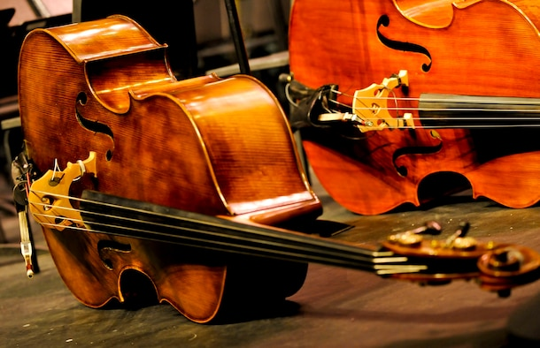 "A upright bass played by a member of the U.S. Air Force Heritage of America Band lays on stage prior to the start of the ""Side by Side"" concert at Warhill High School in Williamsburg, Va., Nov. 14, 2013. The concert featured more than 90 musicians from the USAF Heritage of America Band and the College of William and Mary Wind Ensemble. (U.S. Air Force photo by Staff Sgt. Wesley Farnsworth/ Released)"