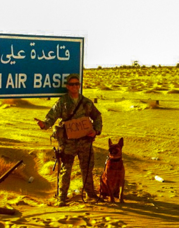 Staff Sgt. Michael Clark, 460th Security Forces Squadron military working dog handler, stands with Buddy, 460th SFS MWD, on the last day of their deployment in Southwest Asia. Buddy is retiring after nearly eight years of military service and will be adopted by Clark, his handler since 2011. (Courtesy photo/Released)
