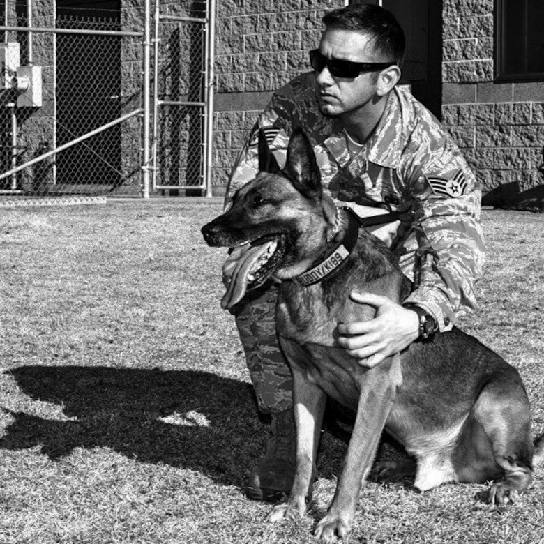 Staff Sgt. Michael Clark, 460th Security Forces Squadron military working dog handler, prepares to train with Buddy, 460th SFS MWD, at the K-9 training yard on Buckley Air Force Base, Colo.  Buddy is retiring after nearly eight years of military service and will be adopted by Clark, his handler since 2011. (Courtesy photo/Released)