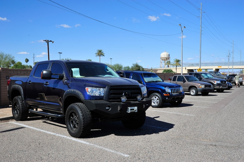 A variety of used cars are for sale at the Luke Air Force Base lemon lot, located behind the bowling alley. The lemon lot has used cars, trucks, SUVs, RVs and boats that are for sale by owner. For more information, call 623-856-6267. (U.S. Air Force photo/Senior Airman Grace Lee)