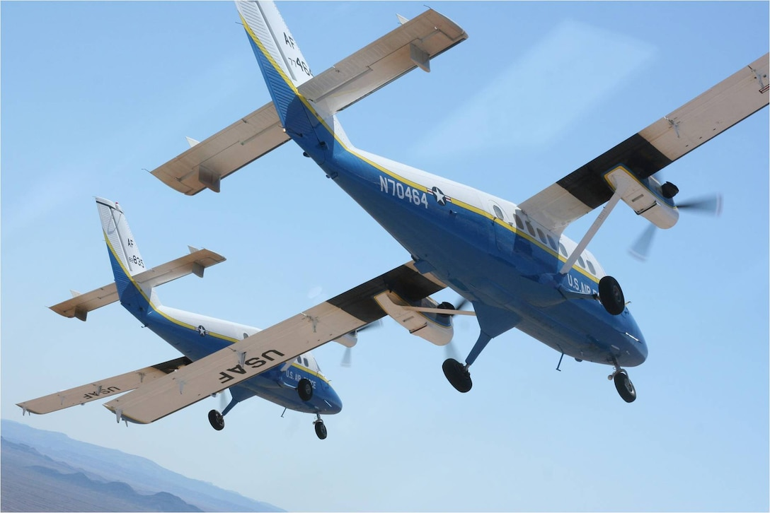 A U.S. Air Force Academy Twin Otter UV-18B flies over the Academy. This airlift support plane is used for cadet parachuting and the Air Force Wings of Blue parachute team. The Academy hosted a town hall meeting on Nov. 12 with Colorado Springs residents to discuss recent FAA-mandated changes to it's training flying pattern.