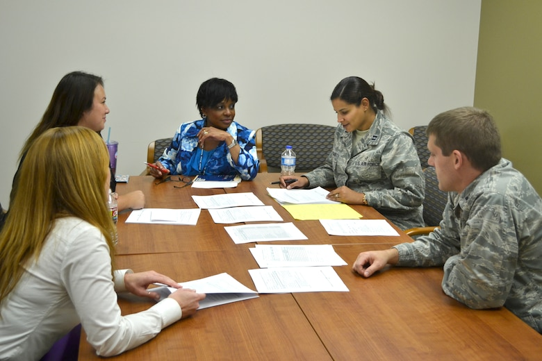 Mental Health Flight personnel meet. From left to right: Licensed Clinical Social Worker Hollis Ferrell, Psychologist Jerri Turner, Licensed Clinical Social Worker Valerie Tucker, Psychologist Capt. Mayrin Munguia and Psychologist Capt. Spencer Clayton.(Air Force photo by Brandice J. O'Brien)