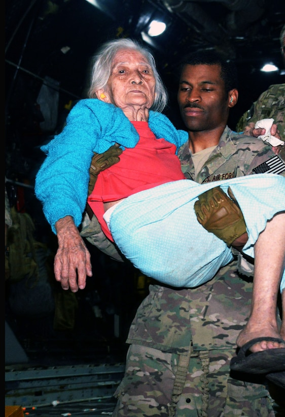 Tech. Sgt. David D. Wheeler carries a displaced person off an MC-130P Combat Shadow, Nov. 14, 2013 at Tacloban Airport, Philippines. The displaced people were transported to safety in Manila. Members of Air Force Special Operations Command are deployed alongside U.S. Marine Corps Forces Pacific and the Armed Forces of the Philippines in support of Operation Damayan to provide humanitarian assistance in the aftermath of Typhoon Haiyan. Wheeler is a loadmaster with the 17th Special Operations Squadron. (U.S. Air Force photo/Tech. Sgt. Kristine Dreyer)