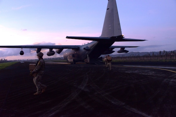 Airmen from the 353rd Special Operations Group offload equipment from an MC-130H Combat Talon II Nov. 15, 2013 at Ormoc Airport, Philippines. The Airmen, deployed in support of Operation Damayan, are assisting the Armed Forces of the Philippines and U.S. Marine Corps Forces Pacific as they provide aid in the aftermath of Typhoon Haiyan. (U.S. Air Force photo/Tech. Sgt. Kristine Dreyer)
