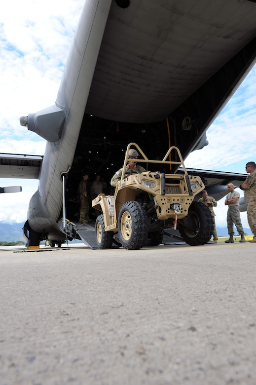 U.S. Special Forces operators from the 7th Special Forces Group (Airborne) exit a C-130 Hercules aircraft as part of RAPIDS infiltration/exfiltration training at Soto Cano Air Base, Nov. 15, 2013.  RAPIDS is a Special Forces tactic for quickly inserting and removing personnel into and out of an area, and is used for personnel recovery of an isolated individual.  (Photo by Martin Chahin)