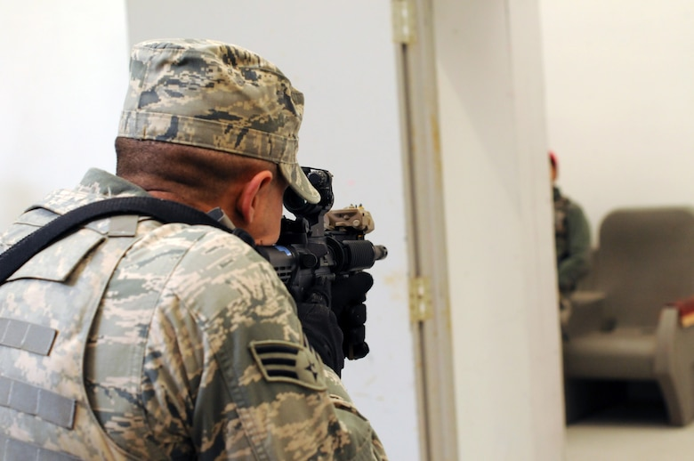 An airman from the 177th Security Forces Squadron practices clearing a room during an exercise scenario on Nov.16, 2013 at the FAA Training Facility, N.J.  Airmen practiced scenarios ranging from room clearing to entry procedures during the exercise.  (U.S. Air National Guard photo by Airman First Class Shane Karp/Released)