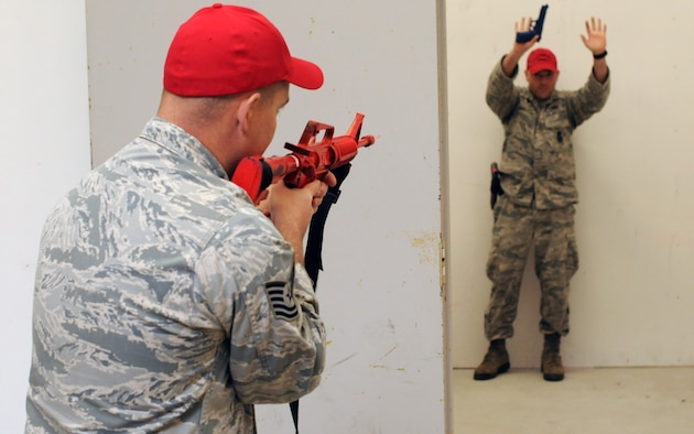 A picture of Airmen from the 177th Security Forces Squadron practicing room clearing procedures.