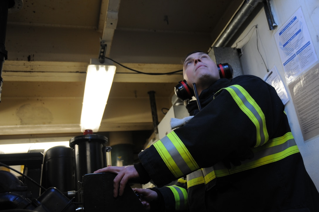An airman from the 177th Civil Engineering Squadron Fire Department awaits a signal during a test of the runway aircraft arrest system Nov. 14, 2013, at the 177th Fighter Wing at Atlantic City Air National Guard Base, N.J. The arrest system is used to stop aircraft in the event of a brake failure and must be tested yearly. (U.S. Air National Guard photo by Airman First Class Shane Karp/Released)