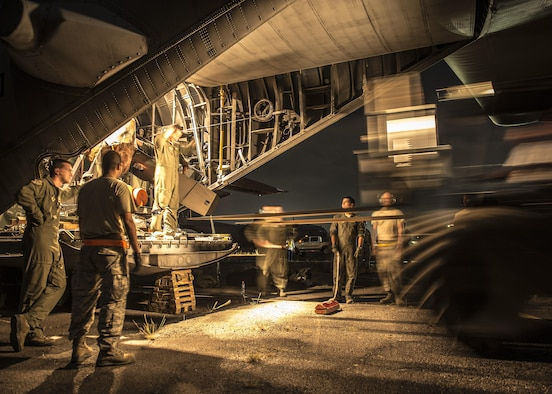 Airmen from Yokota Air Base, Japan, offload equipment from a C-130 Hercules at Clark Air Base, Republic of the Philippines, Nov. 16, 2013. The C-130 is considered a tactical airlift workhorse; capable of preforming air-land and airdrop missions out of remote locations.
