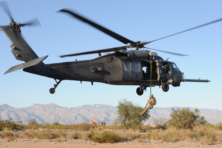 A U.S. Air Force combat rescue officer from the 48th Rescue Squadron at Davis-Monthan Air Force Base, Ariz. descends on a fast rope during alternate insertion and extraction training here, Nov. 13, 2013. (U.S. Air Force photo by 1st Lt Sarah Ruckriegle/released)