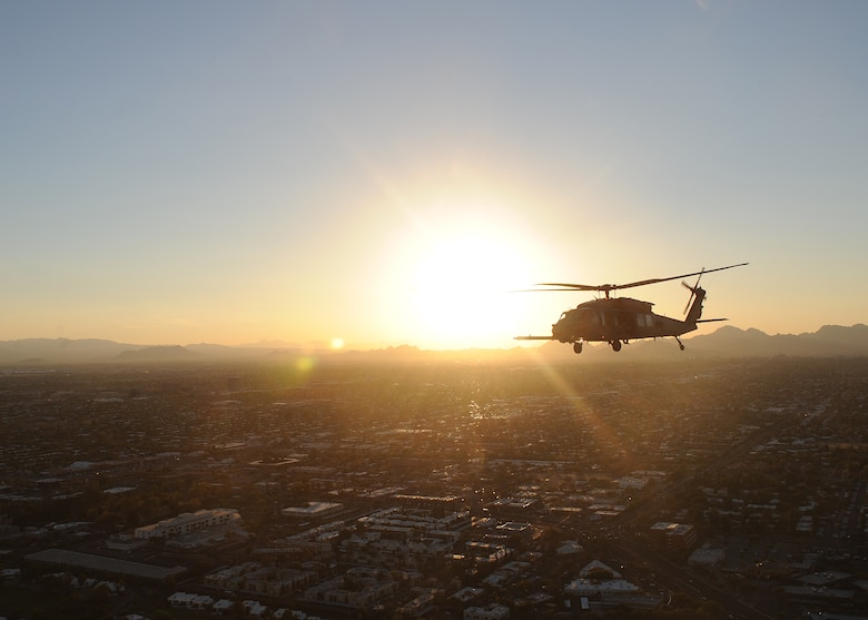 An HH-60 Pavehawk from the 55th Rescue Squadron at Davis-Monthan Air Force Base, Ariz., flies over Tucson during alternate insertion and extraction training with the pararescuemen of the 48th Rescue Squadron, Nov. 13, 2013.  (U.S. Air Force photo by 1st Lt Sarah Ruckriegle/released)