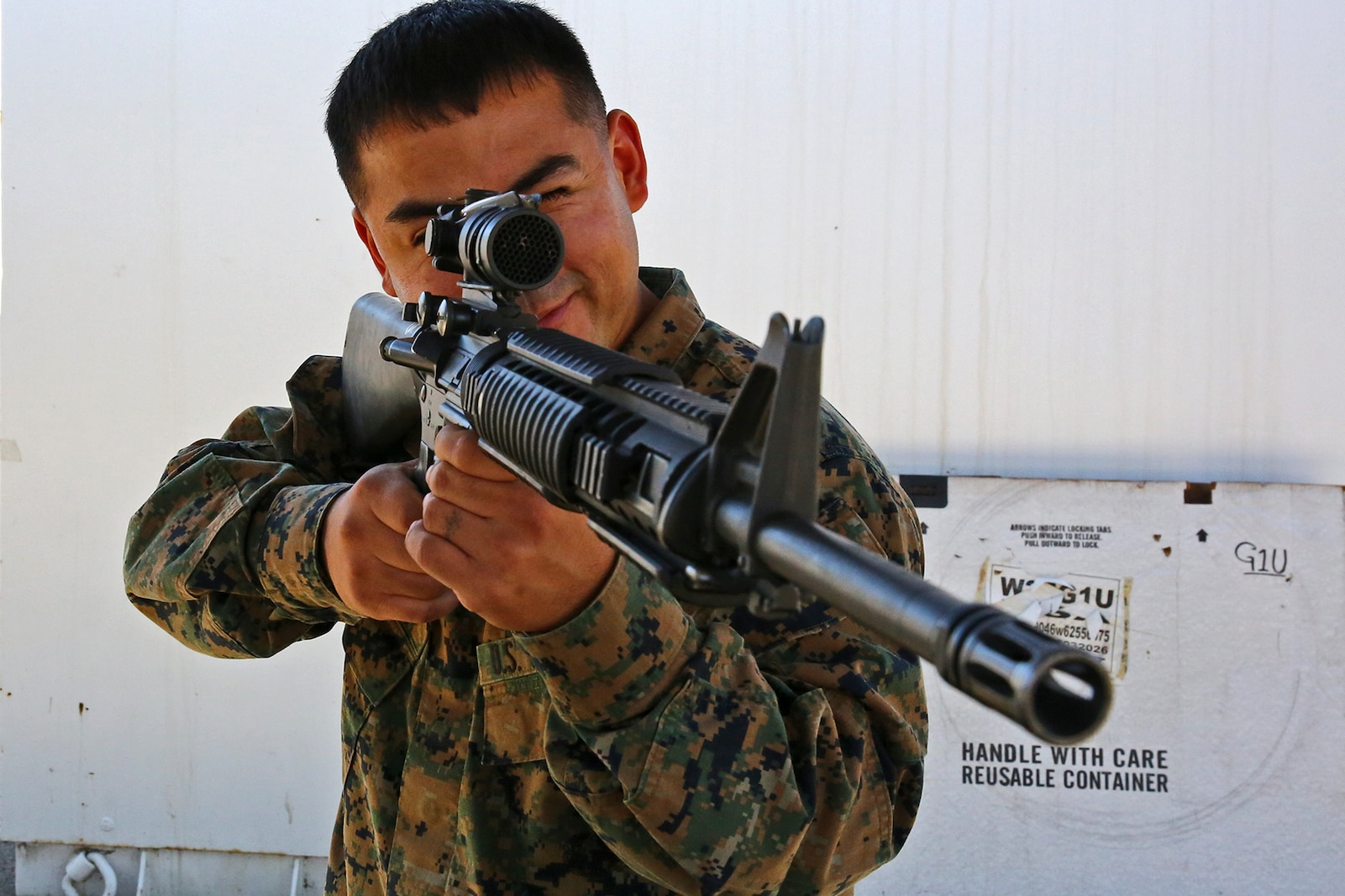 Corporal Dehorta, a small arms repair technician, Combat Logistics Battalion 15, Combat Logistics Regiment 17, 1st Marine Logistics Group, completes a functions check of a weapon by ensuring the optic is in working order aboard Camp Pendleton, Calif., Nov. 13, 2013. As a lance corporal, he was the Marine of the Quarter and the Marine of the Year. Now he is the Noncommissioned Officer of the Quarter.