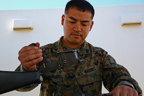 Corporal Dehorta, asmall arms repair technician, Combat Logistics Battalion 15, Combat Logistics Regiment 17, 1st Marine Logistics Group, takes apart a weapon to ensure that each piece functions properly aboard Camp Pendleton, Calif., Nov. 13, 2013. As a lance corporal, he was the Marine of the Quarter and the Marine of the year. Now he is the Noncommissioned Officer of the Quarter.