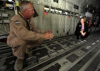 Senior Master Sgt. Thomas Maddock shows Ms. Heidi Grant features on the C-130J Hercules during the 2013 Dubai Airshow at the Dubai World Central airport in Jebel Ali, Nov. 18, 2013. Maddock is a C130J loadmaster deployed from Keesler Air Force Base, Miss., and a Navarre, Fla., native. Grant is the deputy undersecretary of the Air Force for International Affairs. (U.S. Air Force photo/Senior Airman Bahja J. Jones)