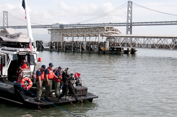 A Coast Guard Diver enters the water during a simulated disaster response at Pier 1 in San Francisco, Nov. 18.