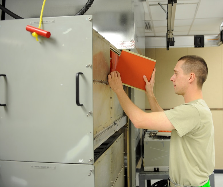 U.S. Air Force Senior Airman Cody Gregory, 7th Component Maintenance Squadron avionics maintenance technician, carefully installs placeholders into a digital-analog video testing station Nov. 13, 2013, at Dyess Air Force Base, Texas. Placeholders are used to maintain proper airflow to keep electrical equipment cool. (U.S. Air Force photo by Airman 1st Class Kedesha Pennant/Released)