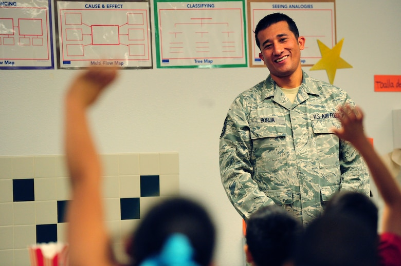 Tech. Sgt. Phillip Borja, 99th Logistics Readiness Squadron weapons vault supervisor, takes questions from students during his presentation Nov. 8, 2013 at Doris French Elementary School in Las Vegas. Following their presentations, Airmen took time to answer questions regarding life in the military and personal experiences. (U.S. Air Force photo by Airman 1st Class Joshua Kleinholz)