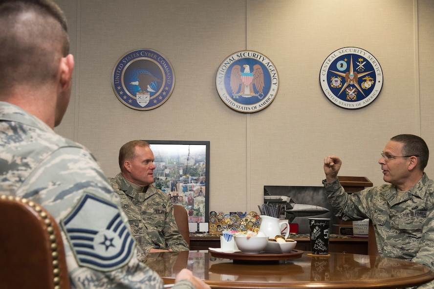 Chief Master Sgt. of the Air Force James A. Cody, middle, meets with Chief Master Sgt. Kevin Slater, senior enlisted leader for USCYBERCOM and NSA/CSS, right, Nov. 12 to talk about cyber training and readiness and Airmen serving in intelligence and cyber specialties. The meeting was part of a larger trip to meet with AFCYBER and AFISRA units here. (U.S. Air Force Photo/Released)