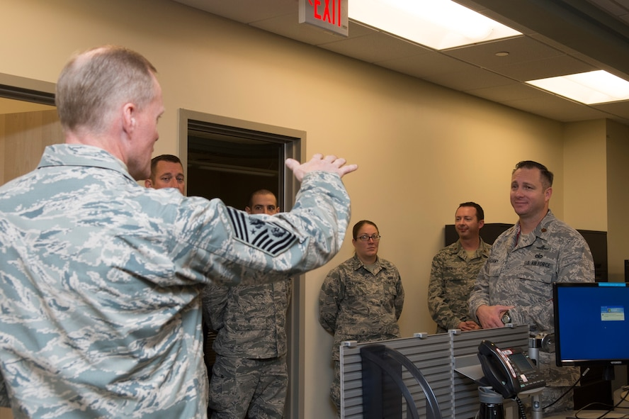 Chief Master Sgt. of the Air Force James A. Cody responds to a question from one of the officers in the 315th Network Warfare Squadron here Nov. 12. Cody met with Airmen from units in AFCYBER and AFISRA to learn more about the Air Force's cyber and intelligence missions, as well as answer questions on Air Force-related topics. (U.S. Air Force Photo/Released)