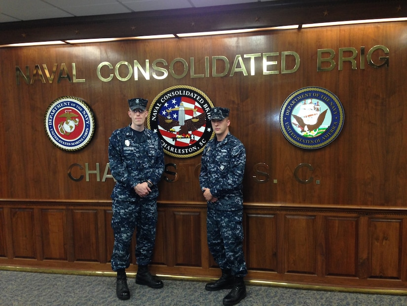 Petty Officer 1st Class Ian Wakefield, a Religious Program Specialist (left), and Petty Officer 2nd Class Michael McNeil, an Operations Specialist, have been named the Naval Consolidated Brig Charleston's 2013 Sailor and Junior Sailor of the Year.