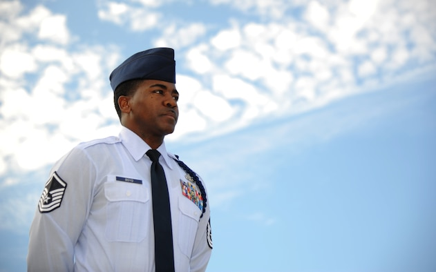 Master Sgt. Terrance Boyd, 334th Training Squadron flight chief military training flight, stands at attention Nov. 18, 2013, at Avery Manor, Keesler Air Force Base, Miss.  Boyd was recently selected as the 2013 Air Education and Training Command junior enlisted category Lance P. Sijan award winner.  (U.S. Air Force photo by Kemberly Groue)