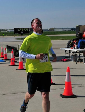 Senior Master Sgt. Dave Stevens crosses the finish line at the C-5 K Fun Run at the 167th Airlift Wing, April 27, 2013. Running became an integral part of Stevens' quest for a healthier lifestyle. (Air National Guard photo by Tech. Sgt. Robert Fluharty)