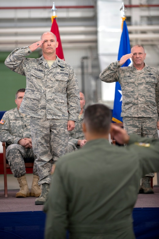 Col. Shaun Perkowski, left, incoming commander for the 167th Airlift Wing, renders his first official salute as commander during the change of command ceremony, Nov. 15. Outgoing commander, Col. Roger Nye, right, is retiring after 35 years of service, the last six of which he served as commander of the 167AW. (Air National Guard photo by: Master Sgt. Emily Beightol-Deyerle)