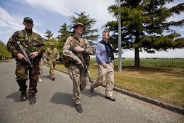 Lt. Col. Rose King, commanding officer of 2 Combat Service Support Battalion, from Palmerston North, New Zealand, escorts Dr. Jonathan Coleman, New Zealand Minister of Defence, around the Combined Joint Inter-Agency Task Force headquarters during exercise Southern Katipo 2013 at Timaru Airfield, New Zealand, Nov. 15. SK13 strengthens military to military relationships and cooperation with partner nations and the New Zealand Defence Force.