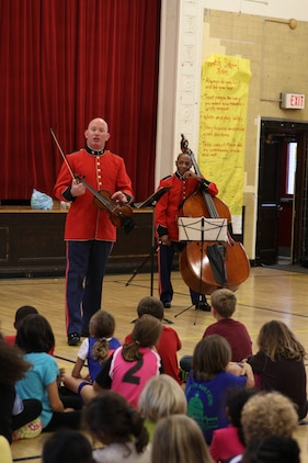 A string duo comprised of MGySgt Peter Wilson and MSgt Aaron Clay performed a Music in the Schools program at Murch Elementary School in Washington, D.C., Nov. 1, 2013. The Marine Band performed for approximately 8,000 students during its Music in the Schools Program, held throughout October.