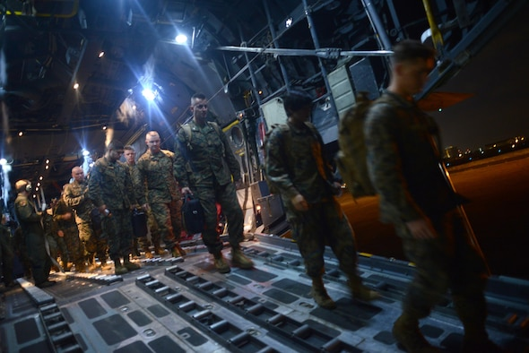 An Air Force C-130 Hercules aircraft delivers Marines to support Operation Damayan Nov. 18, 2013, at Villamor Airfield, Republic of the Philippines.
