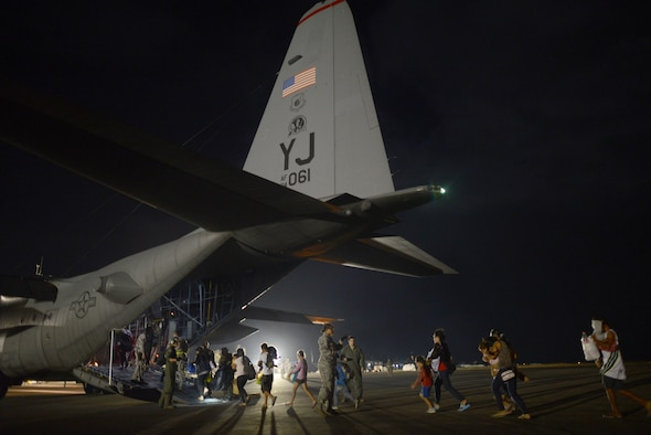 Evacuees board an Air Force C-130 Hercules Nov. 18, 2013, at Tacloban Airport, Republic of the Philippines, during Operation Damayan. The evacuation process was overseen by a joint service operation and the Armed Forces of the Philippines.