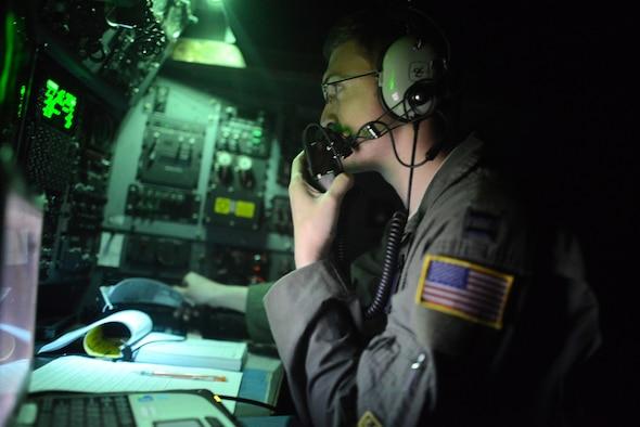 Capt. Jake Morton, a C-130 Hercules aircraft navigator assigned to the 36th Airlift Squadron, Yokota Air Base, Japan, monitors radio traffic Nov. 18, 2013, on approach to Tacloban Airport during Operation Damayan.