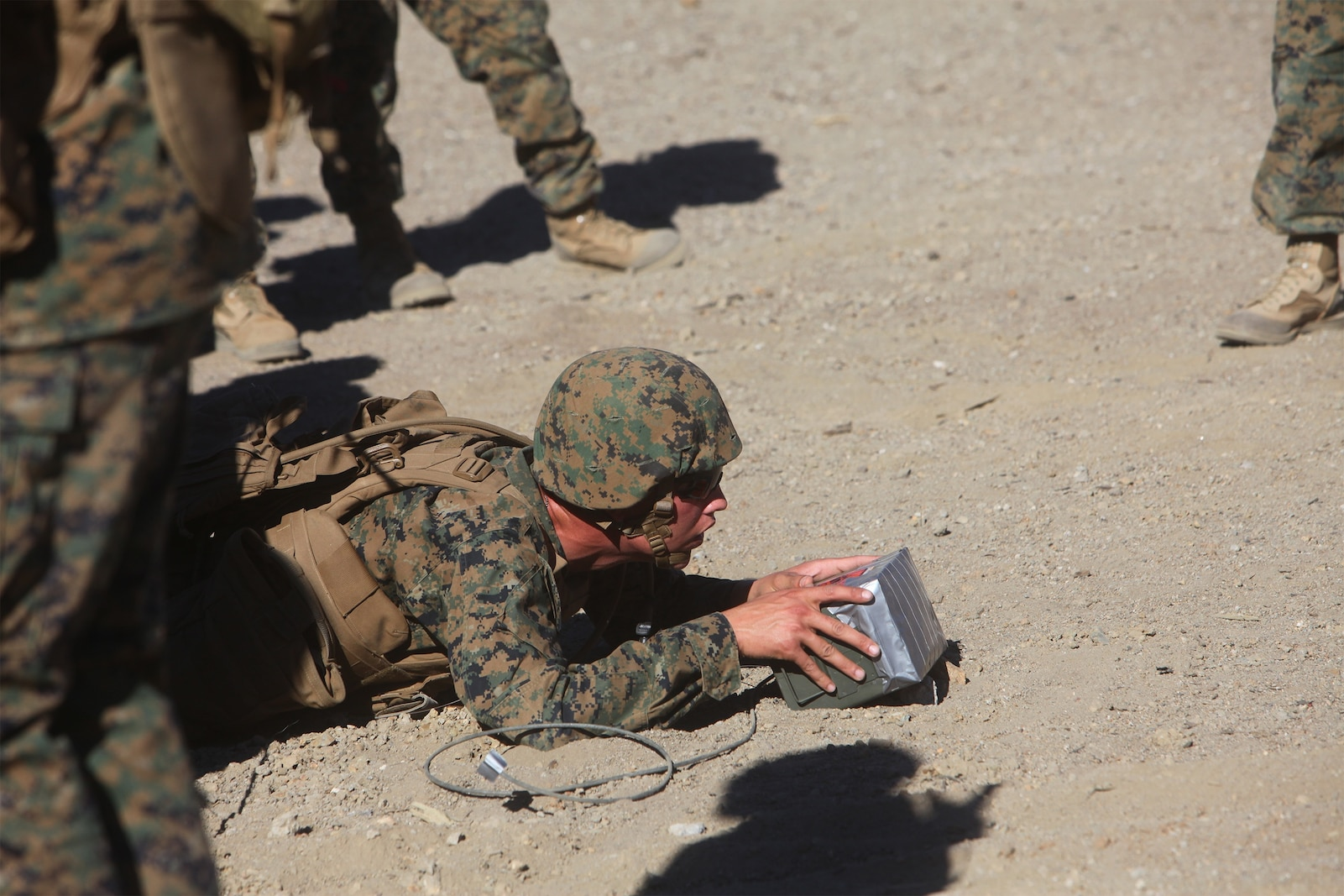 A Marine with Combat Logistics Regiment 17, 1st Marine Logistics Group, emplaces a field-expedient, shaped-charge explosive during a basic demolitions course aboard Camp Pendleton, Calif., Nov. 14, 2013. Approximately 44 Marines from 1st MLG participated in the three-day training course and received instruction on demolitions as well as combat life saving techniques, patrolling and radio operations.