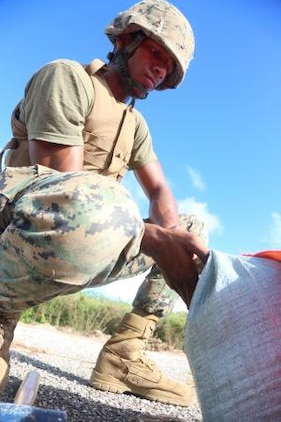 Lance Cpl. Kevin C. Greaves attaches sand bags to a VS-17 platform on Tinian's Backer Runway at North Field Nov. 19, during exercise Forager Fury II. For experienced MMTs, VS-17 platform takes 15-20 minutes to assemble. Greaves is a navigational aids technician and MMT (Marine Air Traffic Controller Mobile Team) member from Brooklyn, N.Y., with Marine Air Control Squadron 4, Marine Air Control Group 18, 1st Marine Aircraft Wing, III Marine Expeditionary Force.