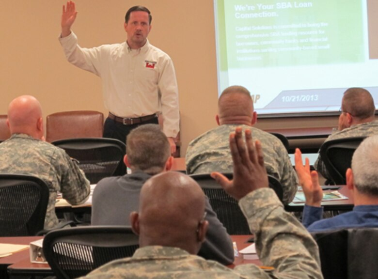 Huntsville Center employee Russ Dunford gives service members and their families a briefing on financial readiness during the Transition Assistance Program workshop held Nov. 18-22 on Redstone Arsenal.