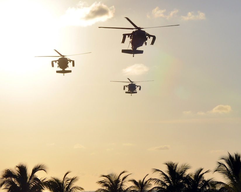 A formation of three UH-60 Blackhawk helicopters assigned to Joint Task Force-Bravo's 1-228th Aviation Regiment makes an approach for a landing at Puerto Castilla, Honduras, Nov. 19, 2013.  The helicopters were flying a mission that was part of a week-long Collective Training Exercise (CTE) being conducted by the 1-228th.  (U.S. Air Force photo by Capt. Zach Anderson)